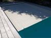 Coberta enrotllable dins de piscina