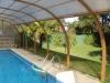 Caberta de piscina imitació fusta.